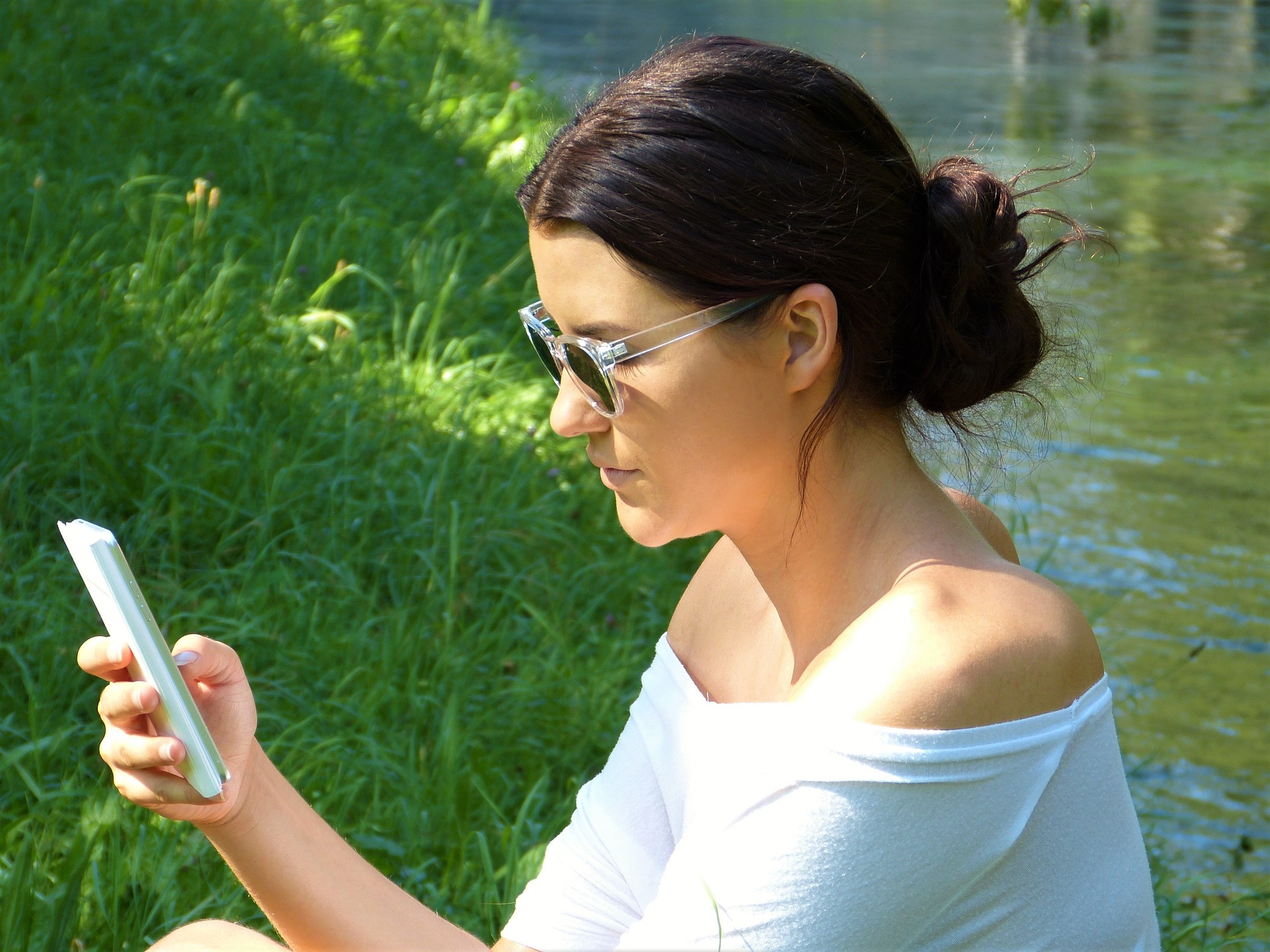 Woman with a smartphone in hands